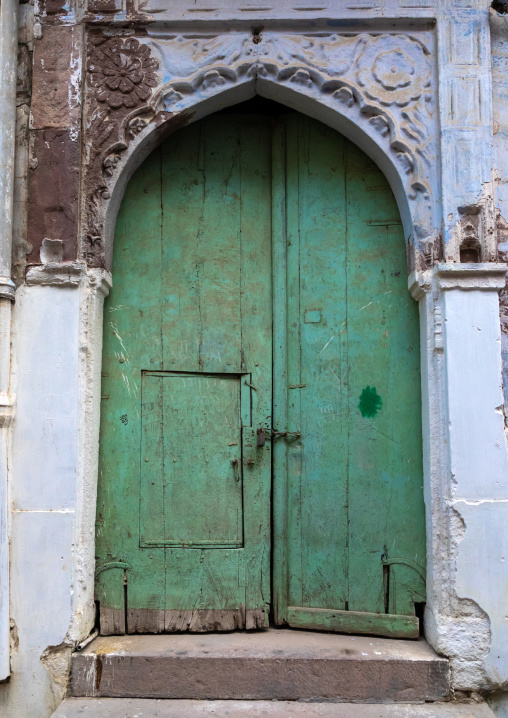 Old green door of a haveli, Rajasthan, Jodhpur, India
