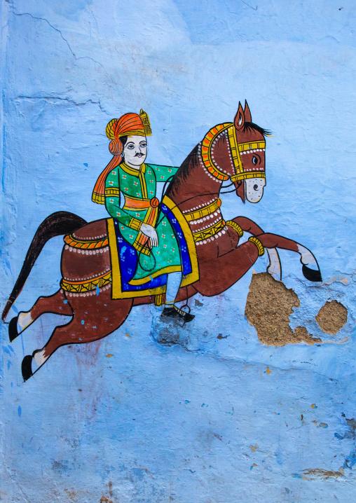 Murals depicting a horseman on an old blue house of a brahmin, Rajasthan, Bundi, India