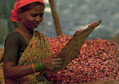 Red Onions Seller Holding A Wicker Tray At The Madurai Market, India