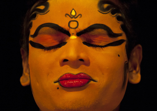 Close Up Of A Kathakali Dancer With Traditional Face Make Up Eyes Closed, Kochi, India