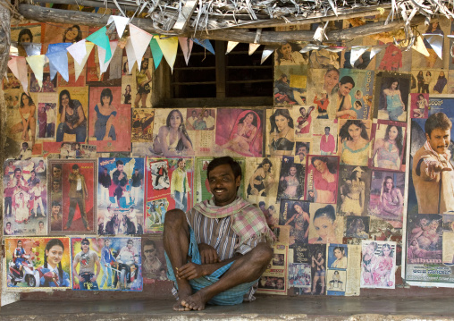 Man Sitting In Front Of His House Covered With Bollywoods Posters, Mysore, India