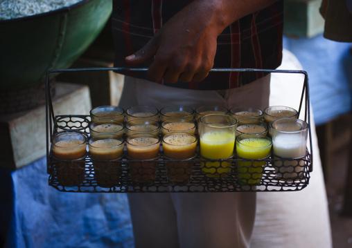 Man Holding A Basket Full Of Milk Tea Drinks, Mysore, India