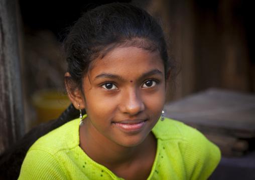 Portait Of A Young Serene Girl Wearing Earrings And Bindi, Chennai, India