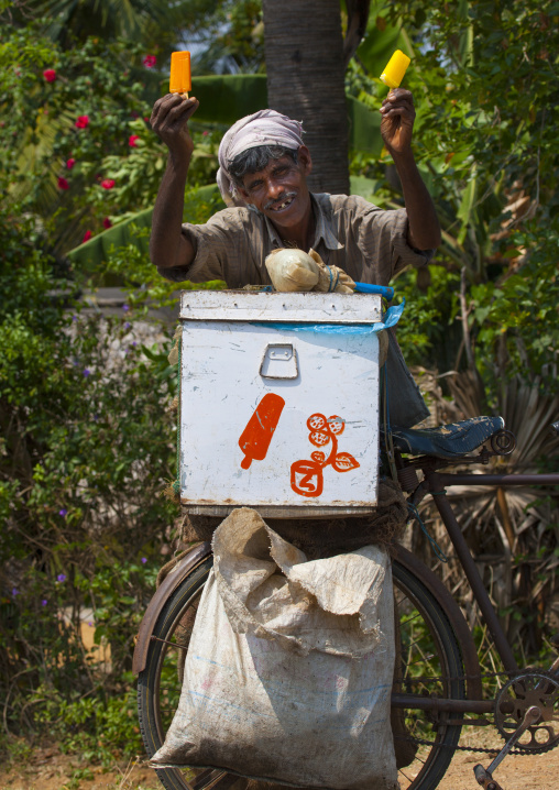 Gap-toothed Smile Of A Ice Cream Seller With His Bicycle, Mahabalipuram, India