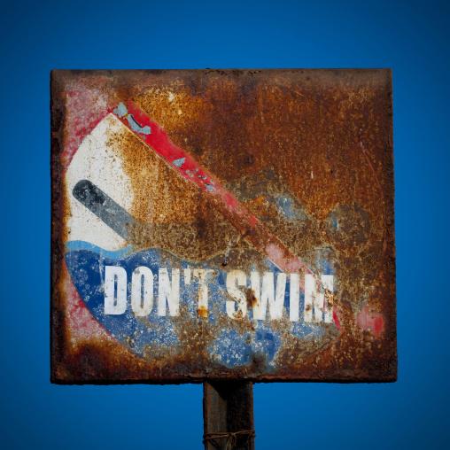 Rusty Do Not Swim Sign In Pondicherry, India