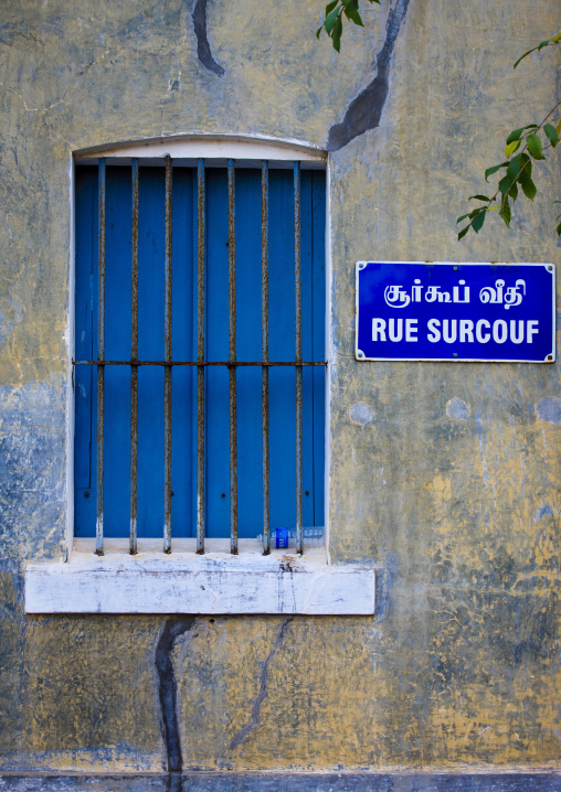 Barred Window With Blue Shutters Closed In Surcouf Street In The French Quater, Pondicherry, India