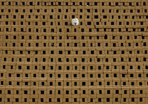 Bricks Protected By A Pumpkin, Pondicherry, India