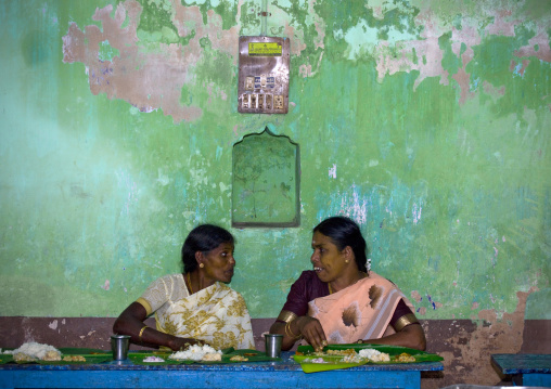 Women In Sari In Front Of A Decrepit Wall Talking During Lunchtime At A Wedding, Kumbakonam, India