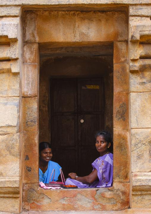 Young Amused Woman Sitting At A Cut In Rock Window At The Brihadishwara Temple, Thanjavur,india