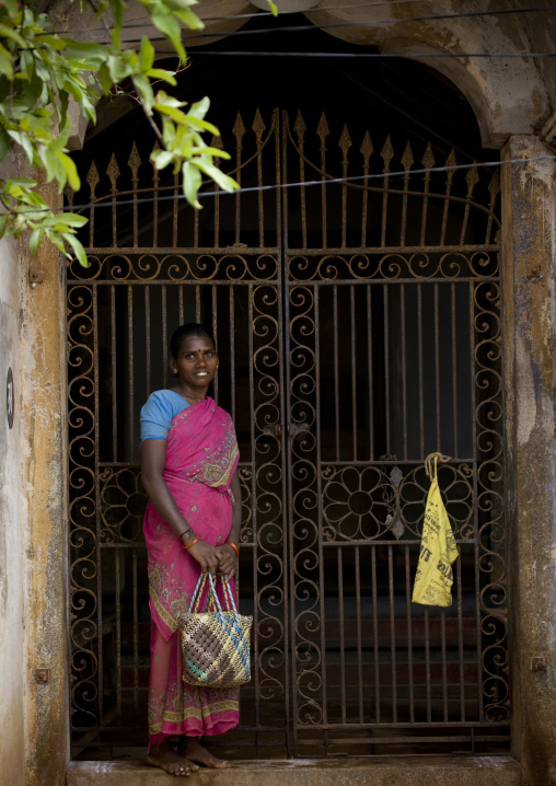 Woman In Sari Holding A Handbag And Smiling In Front Of Her House In Chettinad, India