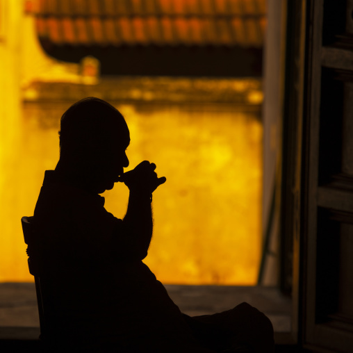 Man Sitting On A Chair Drinking In The Darkness Of His House, Kanadukathan Chettinad, India