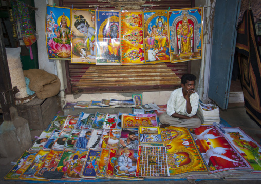 Thoughtful Posters' Seller Sitting Behind His Colorful Stalls, Trichy, India
