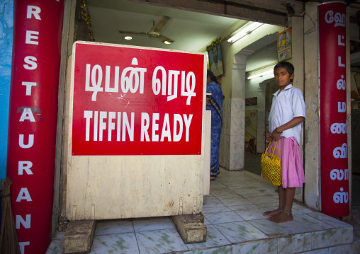 Young Gril With Short Hair Waiting At A Tiffin Restaurant's Entrance Trichy, India