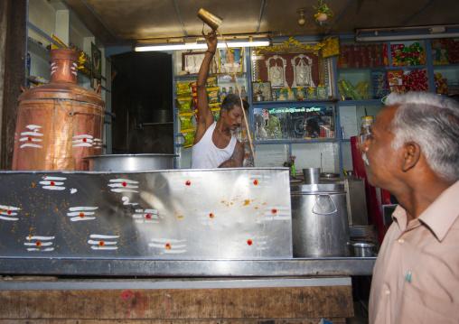 Man Preparing A Beverage Behind His Worktop In A Restaurant, Trichy, India