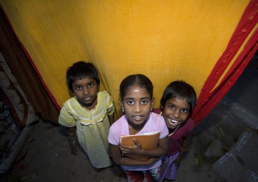 Three Little Indian Grils Posing In Front Of A Colored Curtain, Trichy, India