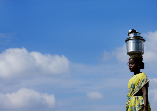 Young Woman Bringing Water On A Jar Posed On The Top Of Her Head In South India, Madurai