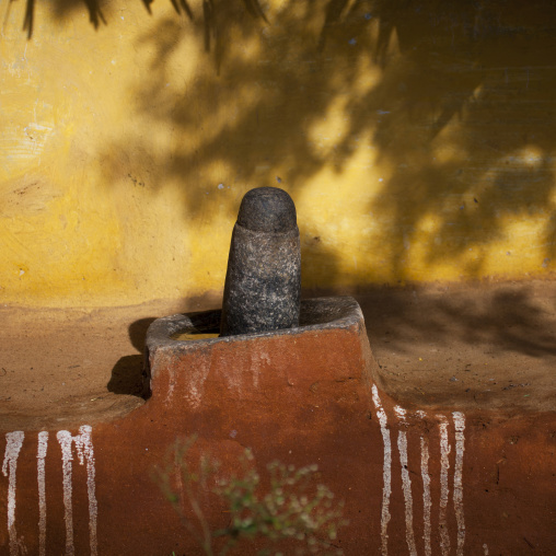 Lingam In Front Of A Adobe House With Painted White Stripes, Madurai, India