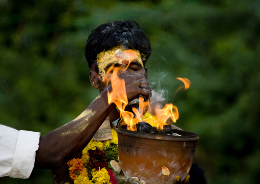 Hand Over A Jar On Fire Held By An Other Man With Closed Eyes And Traditional Painting On His Forehead During Fire Walking Ritual, Madurai, South India
