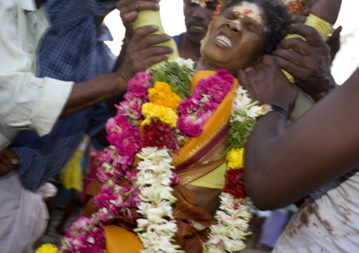 Suffering Woman Wearing Flower Garland Supported By The Crowd During Fire Walking Ritual, Madurai, South India