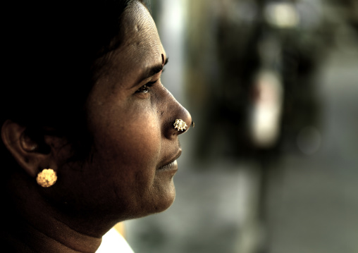 Close Up Of A Woman With Nose Piercings And Bindi Looking Away, Pondicherry, India