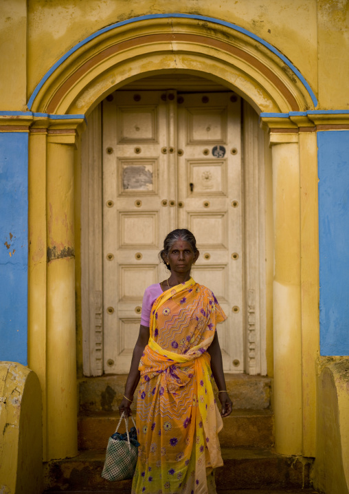 Indian Woman Holding A Handbag Posing In Front Of Her Coloful House In Kanadukathan Chettinad Street, India