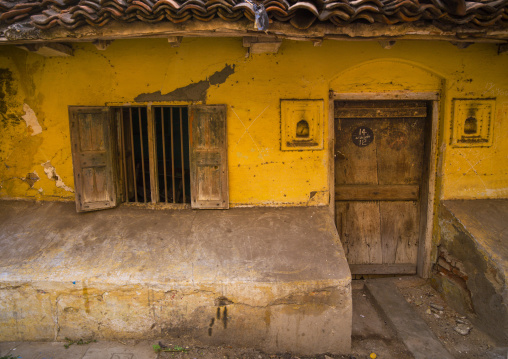 Front Of An Old, Little And Decrepit House With Yellow Wall, Chennai, India