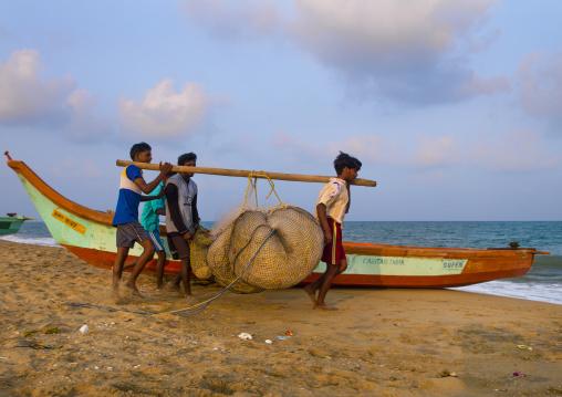 Fishermen Using A Wooden Stick To Carry Their Nets On Mahabalipuram Beach, India
