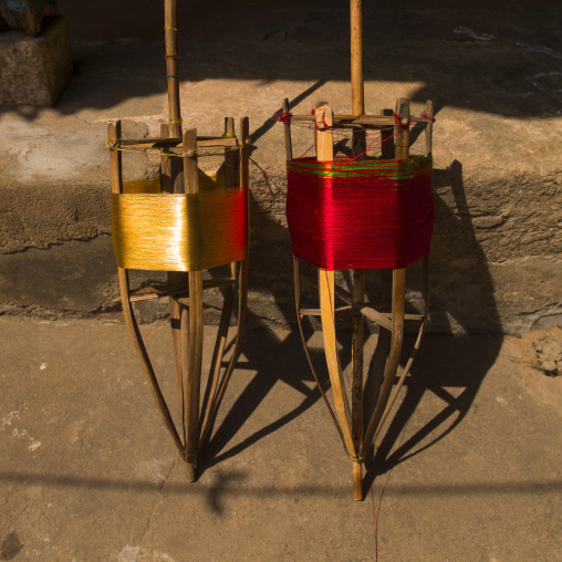 Traditional Wooden Spools Of Red And Golden Yarn, Kumbakonam, India
