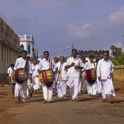 Group Of Musician Men Dressed In White In Procession During A Wedding With Nadaswaram And Thavil In Kanadukathan Chettinad's Street, India