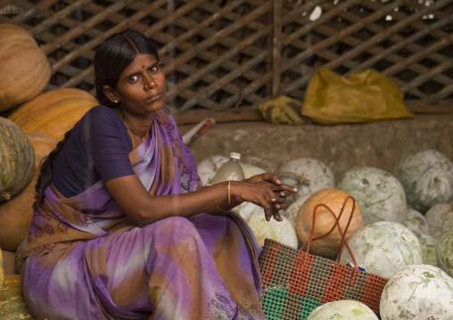 Seller Sitting On Her Stalls Of Pumpkins And Watermelons At Trichy Market, India