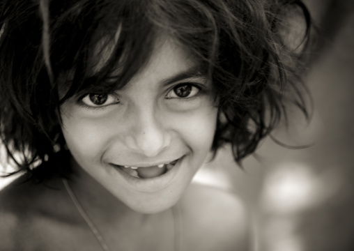 Young Gap-toothed Girl Smiling At The Camera Madurai, India