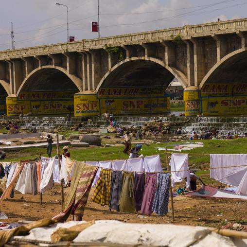 People Washing And Putting Dry Clothes Under A Painted Bridge, Madurai, India
