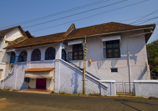 Front Of A Old White House With Blue Windows, Kochi, India