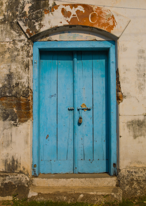 Old Blue Wooden Door With A Padlock Surrounded By Decrepit Walls, Kochi, India