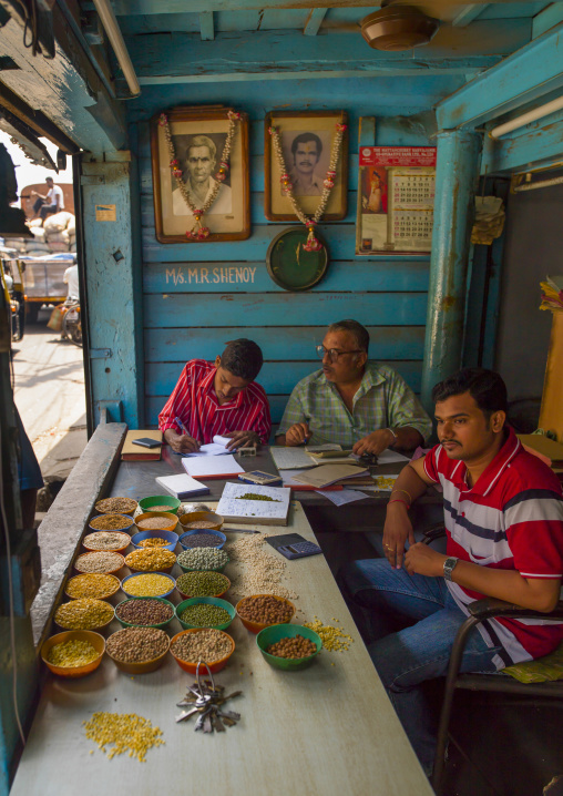 Sellers Of Grains Working On Their Business Behind Their Stalls In Their Store, Kochi, India