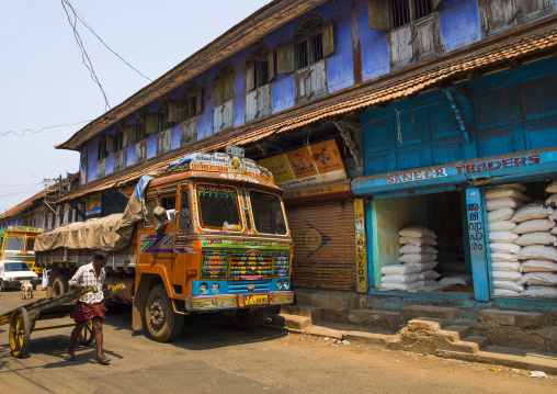 Painted Truck Parked In Front Of A Colorful House In Shopping Street Of Kochi, India