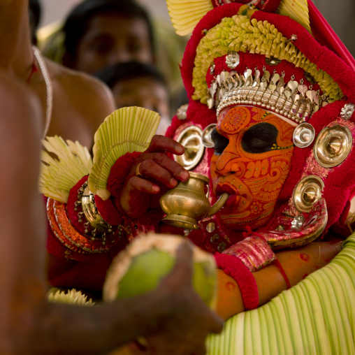 Theyyam Dancer Drinking An Offering Drink During The Ceremony, Thalassery, India