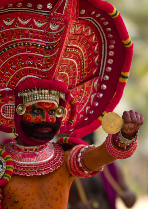 Man Dressed For Theyyam Ritual With Traditional Painting On His Face, Thalassery, India