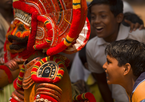 Young Smiling Boys Surrounding Theyyam Artists During The Ritual, Thalassery, India