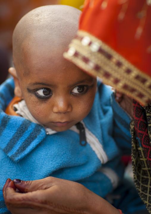 Kid Having His Hair Shaved, Maha Kumbh Mela, Allahabad, India