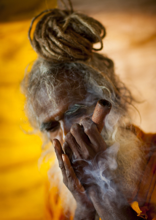 A Naga Sadhu Smoking Pot, Maha Kumbh Mela, Allahabad, India