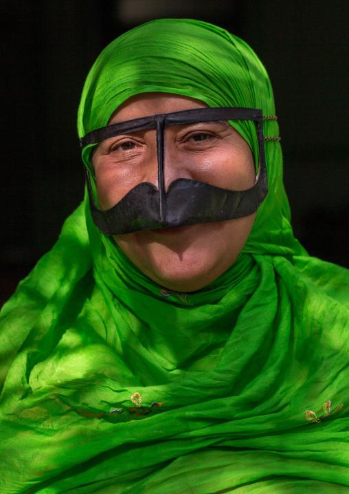a bandari woman wearing a traditional mask called the burqa with a moustache shape, Qeshm Island, Salakh, Iran