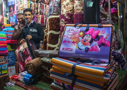 vendors in the bazaar with minnie mouse logos on blankets, Hormozgan, Bandar Abbas, Iran