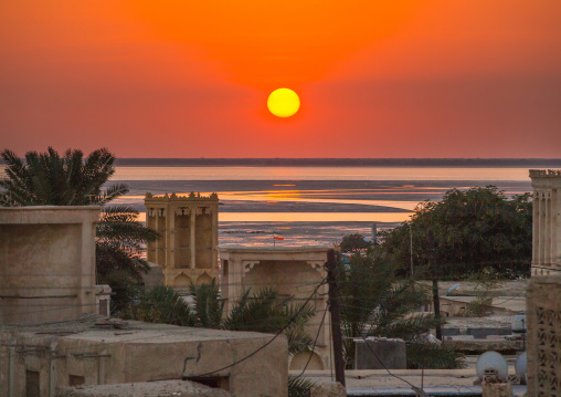 sunset over wind towers used as a natural cooling system in iranian traditional architecture, Qeshm Island, Laft, Iran
