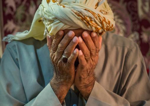 muslim man praying during wedding celebrations, Qeshm Island, Tabl , Iran
