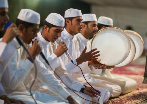 men singing and playing music during a wedding ceremony, Qeshm Island, Tabl , Iran