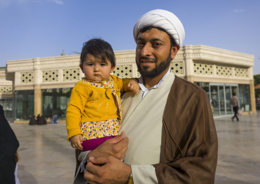 A cleric with his daughter, Qom province, Qom, Iran