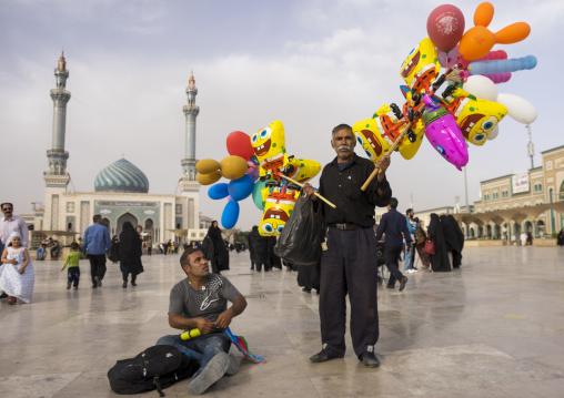 Men selling balloons in front of imam hassan mosque, Qom province, Qom, Iran