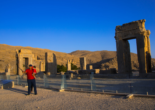 Tourist taking a selfie in the site of Persepolis, Fars Province, Marvdasht, Iran
