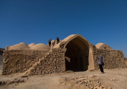 Tourists taking pictures in a zoroastrian old building, Yazd Province, Yazd, Iran